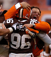 MORNING JOURNAL/DAVID RICHARD.Cleveland defensive coordinator Todd Grantham, right, congratulates Kenard Lang after Lang's pressure on Tennessee quarterback Steve McNair resulted in a Browns' interception on the game's final play yesterday.