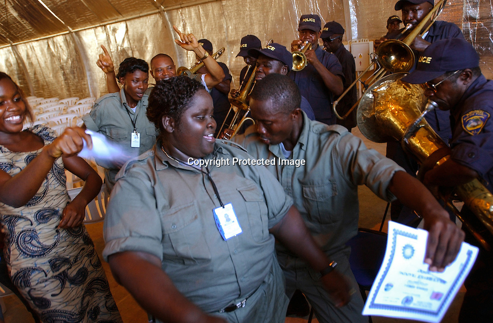Police recruits celebrate after completing their training with UN instructors in Monrovia.