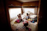 UNITED KINGDOM, Basildon: Irish Traveller children play in a caravan  on the traveller settlement at Dale Farm near Basildon, Essex, south east England, on September 15, 2011. © Christian Minelli.