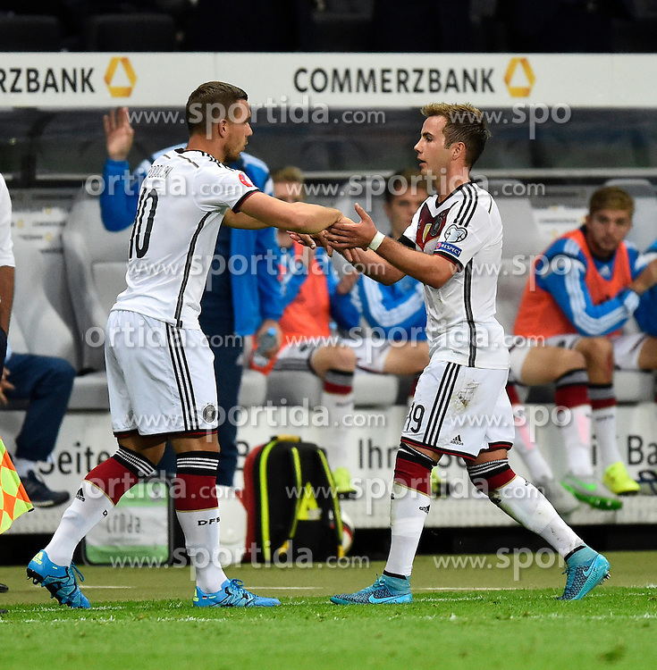 04.09.2015, Commerzbank Arena, Frankfurt, GER, UEFA Euro Qualifikation, Deutschland vs Polen, Gruppe D, im Bild Wechsel, Auswechslung, Einwechslung Mario Goetze (GER) (rechts) geht fuer Lukas Podolski (GER) kurz vor Schluss // during the UEFA EURO 2016 qualifier Group D match between Germany and Poland at the Commerzbank Arena in Frankfurt, Germany on 2015/09/04. EXPA Pictures &copy; 2015, PhotoCredit: EXPA/ Eibner-Pressefoto/ Weber<br /> <br /> *****ATTENTION - OUT of GER*****