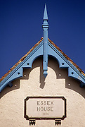 A detail of a Victorian house gable in the Essex seaside town of Frinton-on-Sea. Ornate blue painted woodwork looks fresh and clean despite it being 100 years old. The name of the property reads as Essex House and the date of its construction as 1896. A gable is the generally triangular portion of a wall between the edges of a sloping roof. The shape of the gable and how it is detailed depends on the structural system used (which is often related to climate and availability of materials) and aesthetic concerns. Thus the type of roof enclosing the volume dictates the shape of the gable. A gable wall or gable end more commonly refers to the entire wall, including the gable and the wall below it.