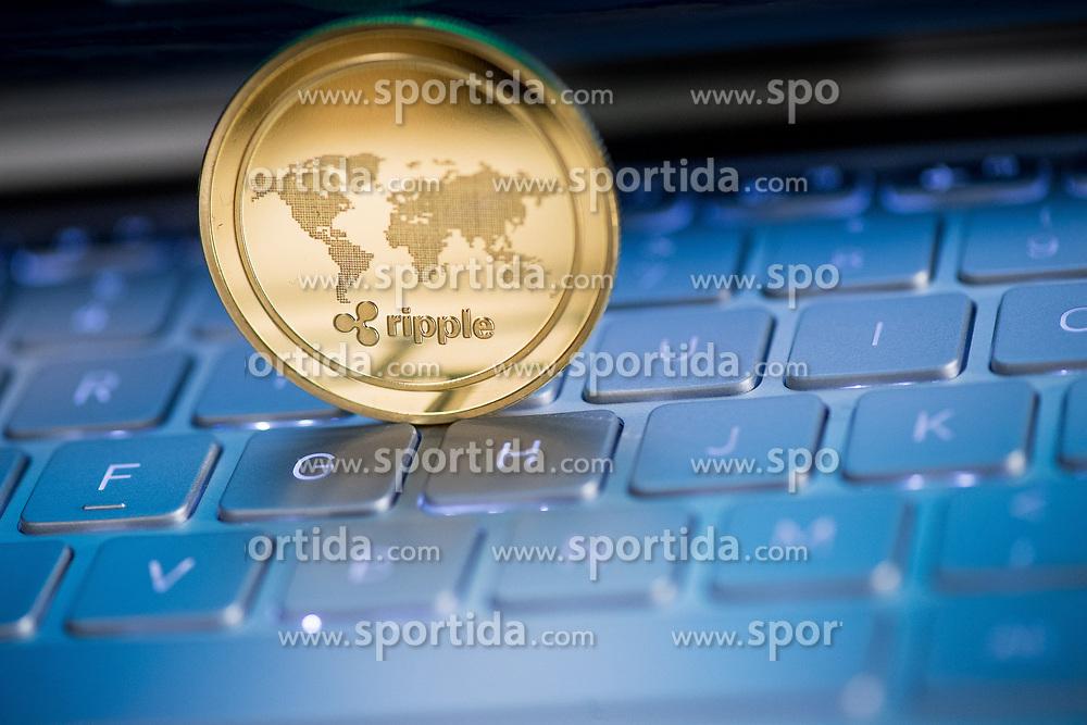 THEMENBILD - Kryptowährung Ripple (XRP) ist ein Open-Source-Protokoll für ein Zahlungsnetzwerk. Ripple soll als Brückenwährung zwischen Währungen, egal ob Fiat-Geld oder Kryptogeld, agieren. Aufgenommen am 15. Feber 2018 in Wien, Österreich // Ripple is a real-time gross settlement system and currency exchange network and it´s cryptocurrency called XRP (ripples). Vienna, Austria on 2018/01/15. EXPA Pictures © 2018, PhotoCredit: EXPA/ Michael Gruber