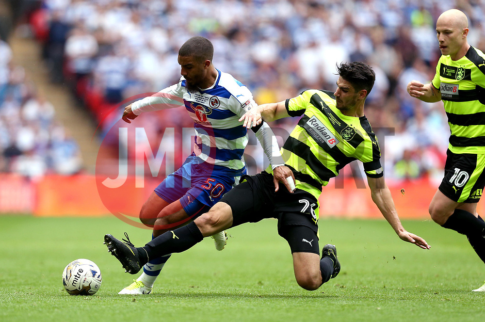 Lewis Grabban of Reading is tackled by Christopher Schindler of Huddersfield Town - Mandatory by-line: Robbie Stephenson/JMP - 29/05/2017 - FOOTBALL - Wembley Stadium - London, England - Huddersfield Town v Reading - Sky Bet Championship Play-off Final