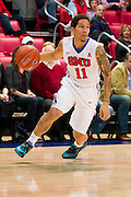 DALLAS, TX - NOVEMBER 26: Nic Moore #11 of the SMU Mustangs brings the ball up court against the Texas Southern Tigers on November 26, 2014 at Moody Coliseum in Dallas, Texas.  (Photo by Cooper Neill/Getty Images) *** Local Caption *** Nic Moore