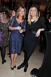 Left to right, ANDREA CATHERWOOD and FIONA PHILLIPS at the 2011 Costa Book Awards held at Quaglino's, 16 Bury Street, London on 24th January 2012.