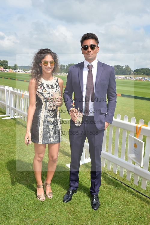 NAOMI DE HAAN and her brother JAKE DE HAAN at the Veuve Clicquot Gold Cup Final at Cowdray Park Polo Club, Midhurst, West Sussex on 20th July 2014.