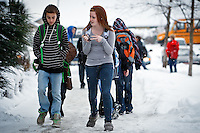 Janelle Burnham talks to her friend Reed Woolsey, both 14, as they walk outside of Canfield Middle School after getting out of class Monday.
