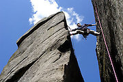 Leon Zablocki climbing Pacemaker HVS at Stanage, nr Sheffield.