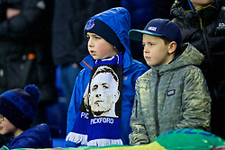 LIVERPOOL, ENGLAND - Sunday, March 3, 2019: A young Everton supporter with a scarf featuring goalkeeper Jordan Pickford during the FA Premier League match between Everton FC and Liverpool FC, the 233rd Merseyside Derby, at Goodison Park. (Pic by Laura Malkin/Propaganda)