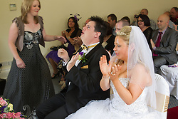 Visually impaired bride and groom at wedding.