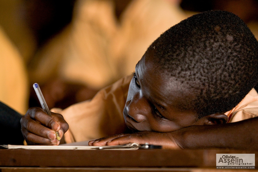 A boy writes in his notebook during class at the Savelugu Junior Secondary School in Savelugu, Ghana on Tuesday June 5, 2007..
