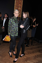 Left to right, OLYMPIA SCARRY and ANNABELLE NEILSON at a private view of the V&A's exhibition Golden Spider Silk held at the Victoria & Albert museum, London on 24t January 2012.