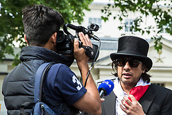 London, UK. 10th June, 2018. Nazim Ali of the Islamic Human Rights Commission is interviewed outside the Saudi embassy before the pro-Palestinian Al Quds Day march through central London. An international event, it began in Iran in 1979. Quds is the Arabic name for Jerusalem.