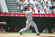 ANAHEIM, CA - APRIL 26:  Third baseman Ty Wigginton #21 of the Tampa Bay Devil Rays hits the ball during the game against the Los Angeles Angels of Anaheim at Angel Stadium in Anaheim, California on April 26, 2007. The Angels defeated the Devil Rays 11-3. ©Paul Anthony Spinelli *** Local Caption *** Ty Wigginton