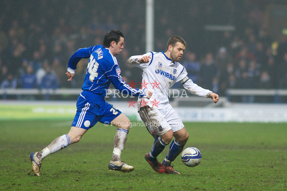 PETERBOROUGH, ENGLAND - Saturday, February 19, 2011: Tranmere Rovers' John Welsh and Peterborough United's Lee Tomlin in action during the Football League One match at London Road. (Photo by Gareth Davies/Propaganda)