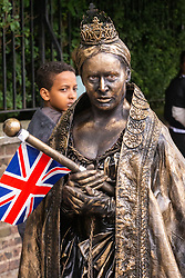 """""""Queen Victoria"""" gets a nervous glance from a child as crowds flock to Lords Cricket Ground, the Home of Cricket to watch the ICC Cricket World Cup final between England and New Zealand. London, July 14 2019."""