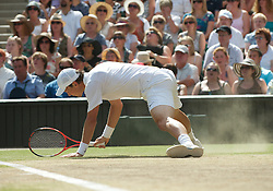 LONDON, ENGLAND - Sunday, July 4th, 2010: Tomas Berdych (CZE) slips in the dust during the Gentlemen's Singles Final match on day thirteen of the Wimbledon Lawn Tennis Championships at the All England Lawn Tennis and Croquet Club. (Pic by David Rawcliffe/Propaganda)