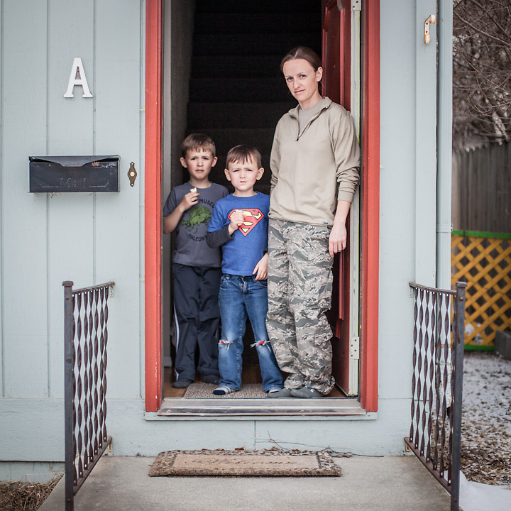 """Air Force Pharmacy Tech Marian McLaughlin and her sons, Conner (7) and Keagan (5), at the front door of her home in Anchorage's South Addition.  """"I really don't know what I want to be…I'm fairly sure I don't want to be a pharmacist.  Right now, I love living downtown…this may be the best kept secret in town.""""  mariangmclaughlin@gmail.com"""