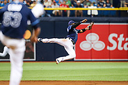 July 8, 2017 - St. Petersburg, Florida, U.S. - WILL VRAGOVIC   |   Times.Tampa Bay Rays shortstop Adeiny Hechavarria (11) with the flying grab on the liner by Boston Red Sox designated hitter Hanley Ramirez (13) in the second inning of the game between the Boston Red Sox and the Tampa Bay Rays at Tropicana Field in St. Petersburg, Fla. on Saturday, July 8, 2017. (Credit Image: © Will Vragovic/Tampa Bay Times via ZUMA Wire)