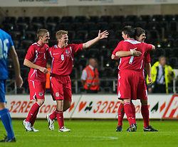 SWANSEA, ENGLAND - Friday, September 4, 2009: Wales' Andy King and Christian Ribeiro celebrate their side's 2-1 victory over Italy during the UEFA Under 21 Championship Qualifying Group 3 match at the Liberty Stadium. (Photo by Gareth Davies/Propaganda)