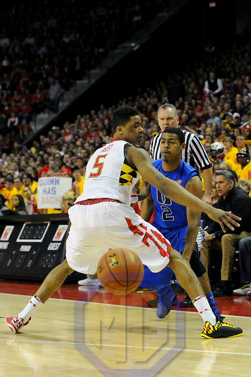 16 February 2013:   Duke Blue Devils guard Quinn Cook (2) in action against Maryland Terrapins guard Nick Faust (5) at the Comcast Center in College Park, MD. where the Maryland Terrapins upset the second ranked Duke Blue Devils, 83-81.