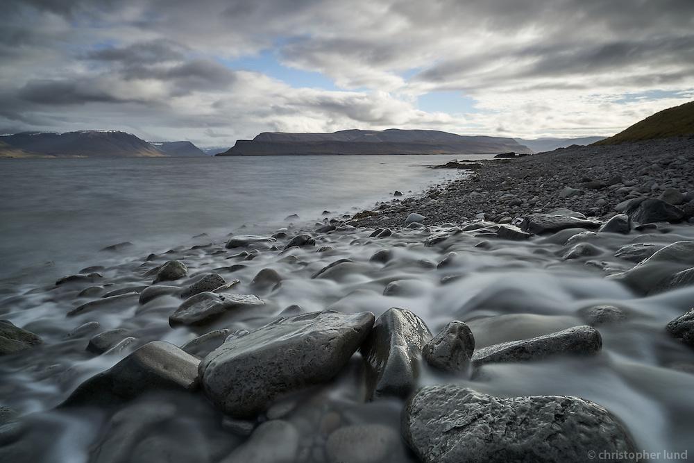 Small stream running into Arnarfjörður, West fiords of Iceland.