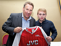 LIVERPOOL, ENGLAND - Friday, May 20, 2011: Paul Merson with a shirt auction winner during the Health Through Sport charity dinner at the Devonshire House. (Photo by David Rawcliffe/Propaganda)