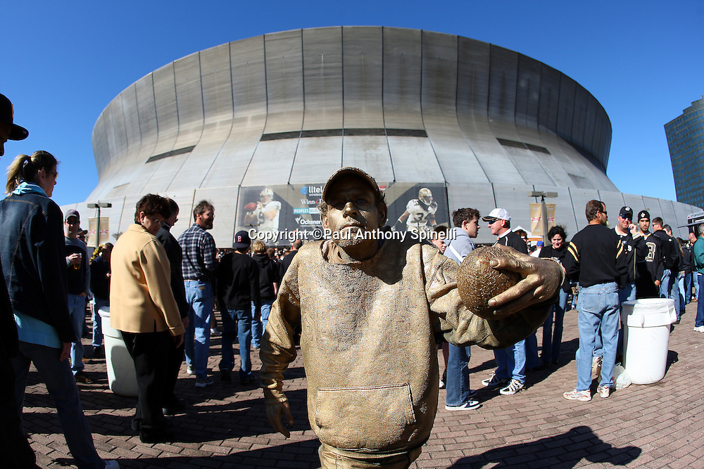 NEW ORLEANS - DECEMBER 07: A New Orleans Saints fan painted gold poses for a  photo outside the stadium before the game against the Atlanta Falcons at the Louisiana Superdome on December 7, 2008 in New Orleans, Louisiana. The Saints defeated the Falcons 29-25. ©Paul Anthony Spinelli
