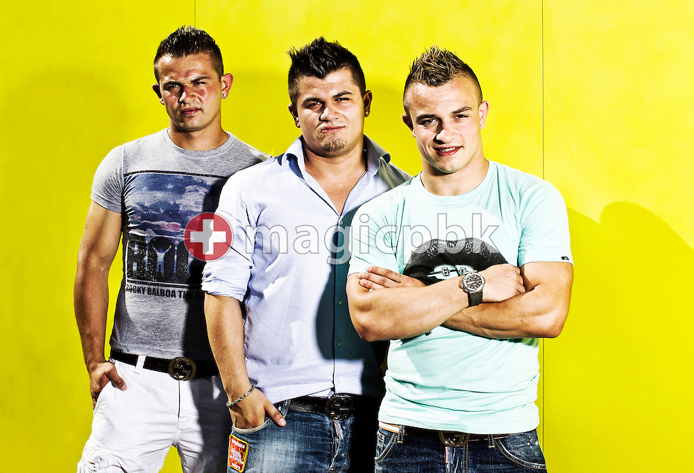 Swiss soccer player Xherdan SHAQIRI (R) of FC Bayern Muenchen poses with his brothers Erdin (C) and Arianit (L) after a training session for kids at the Coca-Cola Junior League tournament in Zurich, Switzerland, Saturday, June 16, 2012. (Photo by Patrick B. Kraemer / MAGICPBK)