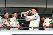 Simon Harmer of Essex drinks from the trophy on the team balcony during the County Championship title celebrations during the Specsavers County Champ Div 1 match between Somerset County Cricket Club and Essex County Cricket Club at the Cooper Associates County Ground, Taunton, United Kingdom on 26 September 2019.