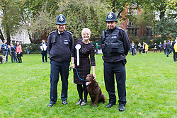 © Licensed to London News Pictures. 26/10/2017. LONDON, UK.  TRACEY BRABIN MP and her dog, Rocky poses for a photograph with two police officers at the Westminster Dog of the Year Competition held in Victoria Tower Gardens. The Westminster Dog of the Year Competition is organised jointly by the Kennel Club and the Dogs Trust..  Photo credit: Vickie Flores/LNP