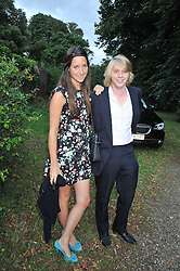 HARRY GRENFELL and INDIA LANGTON at a Summer party hosted by Lady Annabel Goldsmith at her home Ormeley Lodge, Ham, Surrey on 14th July 2009.