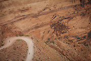 SHOT 10/17/16 11:20:27 AM - Mountain bikers climb and descend the Shafer Trail section of the White Rim Trail. The White Rim is a mountain biking trip in Canyonlands National Park just outside of Moab, Utah. The White Rim Road is a 71.2-mile-long unpaved four-wheel drive road that traverses the top of the White Rim Sandstone formation below the Island in the Sky mesa of Canyonlands National Park in southern Utah in the United States. The road was constructed in the 1950s by the Atomic Energy Commission to provide access for individual prospectors intent on mining uranium deposits for use in nuclear weapons production during the Cold War. Four-wheel drive vehicles and mountain bikes are the most common modes of transport though horseback riding and hiking are also permitted.<br /> (Photo by Marc Piscotty / &copy; 2016)
