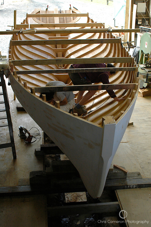Work in progress in the hull of the 26 ft. Pilot Sloop designed by American naval architect George Stadel in 1939, being biult by Herbert Krumm-Gartner at his Classic Boats Ltd workshop outside Auckland. 7/5/04  (© 2004 Chris Cameron)