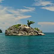 One tree cliffy island.