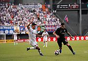 D.C. United midfielder Junior Moreno (5) and FC Cincinnati midfielder Emmanuel Ledesma (45) battle for the ball and position during a MLS soccer game, Thursday, July 18, 2019, in Cincinnati, OH. D.C. United defeated FC Cincinnati 4-1. (Jason Whitman/Image of Sport)