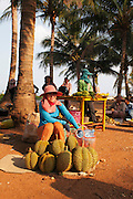 At a small weekend market on Keps coastline Cambodian women sell the fruit durian. Kep in the 1950's and 60's was the most exclusive retreat for the elite of Cambodia. Large villas, including those of the Kings and Prime Minister, dotted this untouched coastline. Then the Khmer Rouge took power and all the villas were either destroyed or left to the jungle, many even today remain in a dilapidated state. But now Kep is rising again and with careful planning may return to its former glory as Cambodia's most exclusive retreat.