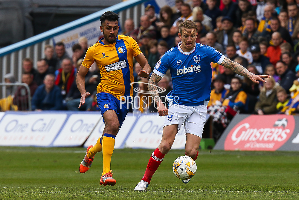 Portsmouth midfielder Carl Baker wins the ball during the EFL Sky Bet League 2 match between Mansfield Town and Portsmouth at the One Call Stadium, Mansfield, England on 29 April 2017. Photo by Aaron  Lupton.