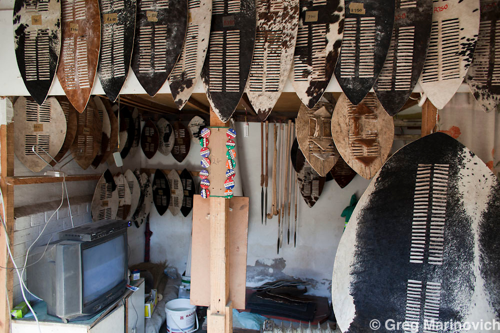 Traditional Zulu attire, sticks, shields, and a contemporary take of Zulu standards with Nike swoosh, Mai Mai market, Johannesburg.  18 Aug 2010. Photo Greg Marinovich