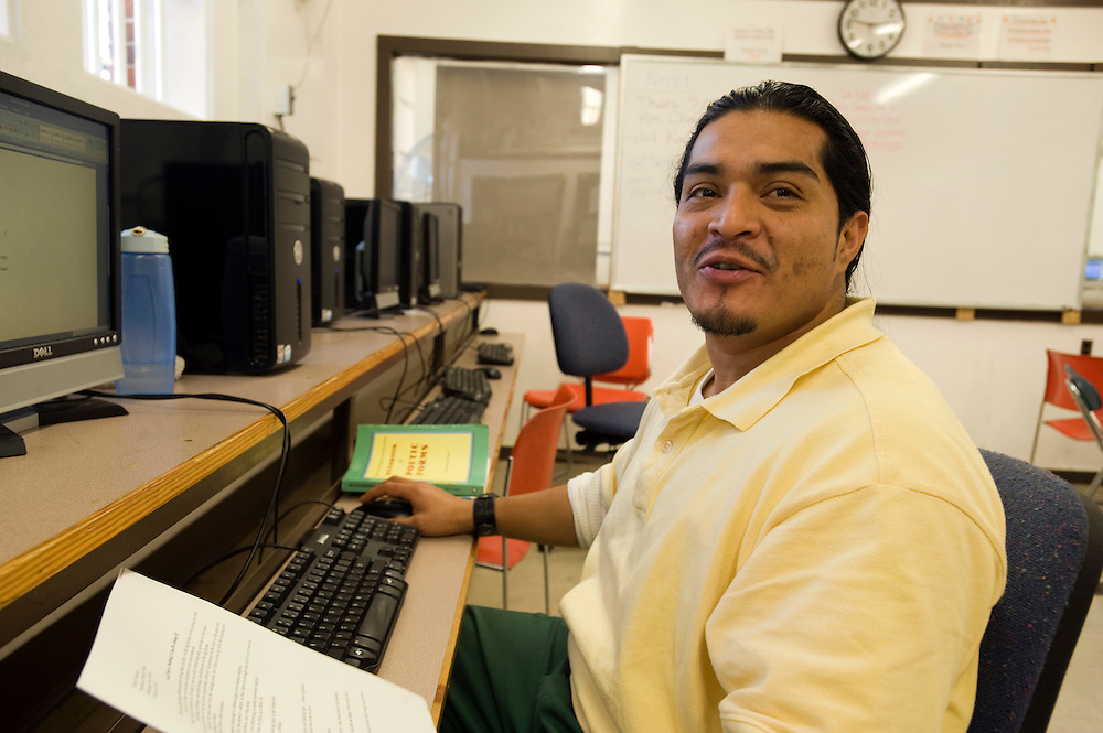 """Woodbourne Correctional Facility inmate and Bard College student Henry Fuentes studies in the computer room...Story: The Bard Prison Initiative.Former inmate Carlos Rosario, 35-year-old husband and father of four, was released from Woodbourne Correctional Facility after serving more than 12 years for armed robbery. Rosado is one of the students participating in the Bard Prison Initiative, a privately-funded program that offers inmates at five New York State prisons the opportunity to work toward a college degree from Bard College. The program, which is the brainchild of alumnus Max Kenner, is competitive, accepting only 15 new students at each facility every other year. .Carlos Rosario received the Bachelor of Arts degree in social studies from the prestigious College Saturday, just a few days after his release. He had been working on it for the last six years. His senior thesis was titled """"The Diet of Punishment: Prison Food and Penal Practice in the Post-Rehabilitative Era,"""".Rosado is credited with developing a garden in one of the few green spaces inside the otherwise cement-heavy prison. In the two years since the garden's foundation, it has provided some of the only access the prison's 800 inmates have to fresh vegetables and fruit...Rosario now works for a recycling company in Poughkeepsie, N.Y...Photo © Stefan Falke"""