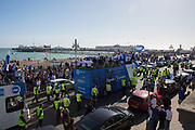 Open top bus and Brighton Pier during the Brighton & Hove Albion Football Club Promotion Parade at Brighton Seafront, Brighton, East Sussex. United Kingdom on 14 May 2017. Photo by Ellie Hoad.