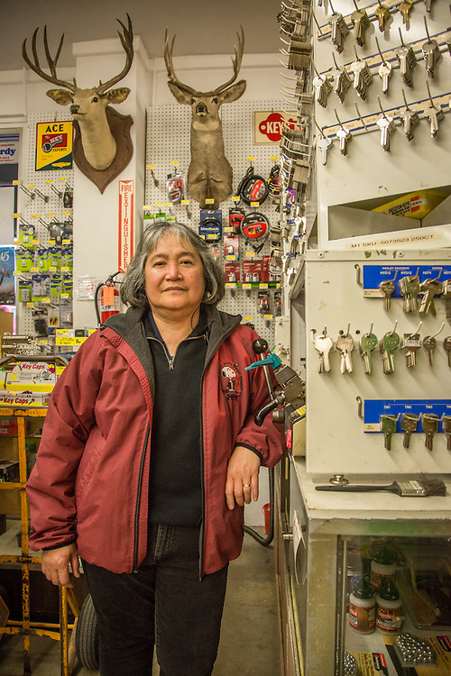"""I've worked here for 17 years.  I live in Windsor...and could work closer to home...but I continue to work here...I will probably retire here.""  -Hardware sales associate Maria Rivera prepares to copy a key at the ACE Hardware store in downtown Calistoga."