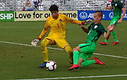 Slovenia defender Jemej Belinc (2) tries to pressure and get off a shot against Canada goalkeeper Dino Bontis (1) during a CONCACAF boys under-15 championship soccer game, Saturday, August 10, 2019, in Bradenton, Fla. Slovenia defeated Canada in 2-1 in overtime and advanced to the finals against Portugal. (Kim Hukari/Image of Sport)