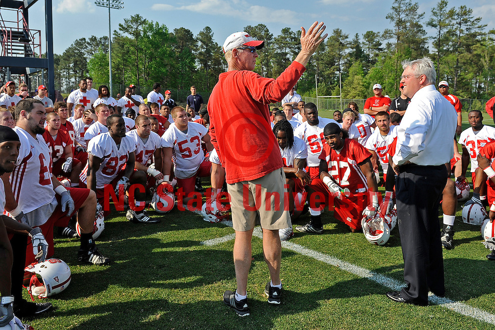 Chancellor Randy Woodson meets with football coach Tom O'Brien at football practice