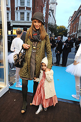 TRINNY WOODALL and her daughter LYLA ELICHAOFF at a party to celebrate the opening of Pincess Marie-Chantal of Greece's store 'Marie-Chantal' 133A Sloane Street, London on 14th October 2008.