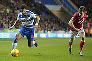 Bristol City midfielder Joe Bryan chases down Reading forward Garath McCleary during the Sky Bet Championship match between Reading and Bristol City at the Madejski Stadium, Reading, England on 2 January 2016. Photo by Jemma Phillips.