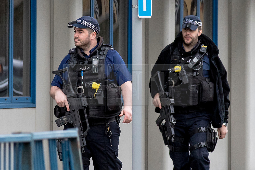 © Licensed to London News Pictures. 05/03/2019. London, UK. Armed police patrol past City Aviation House at London City Airport where police were called to reports of a suspicious package. Suspicious packages have also been found at Heathrow Airport and London Waterloo Station. Photo credit: Rob Pinney/LNP