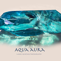 Aqua Aura. Manufactured by placing a clear Quartz Crystal in a vacuum chamber, heating it to 1600 F and adding gold vapour.