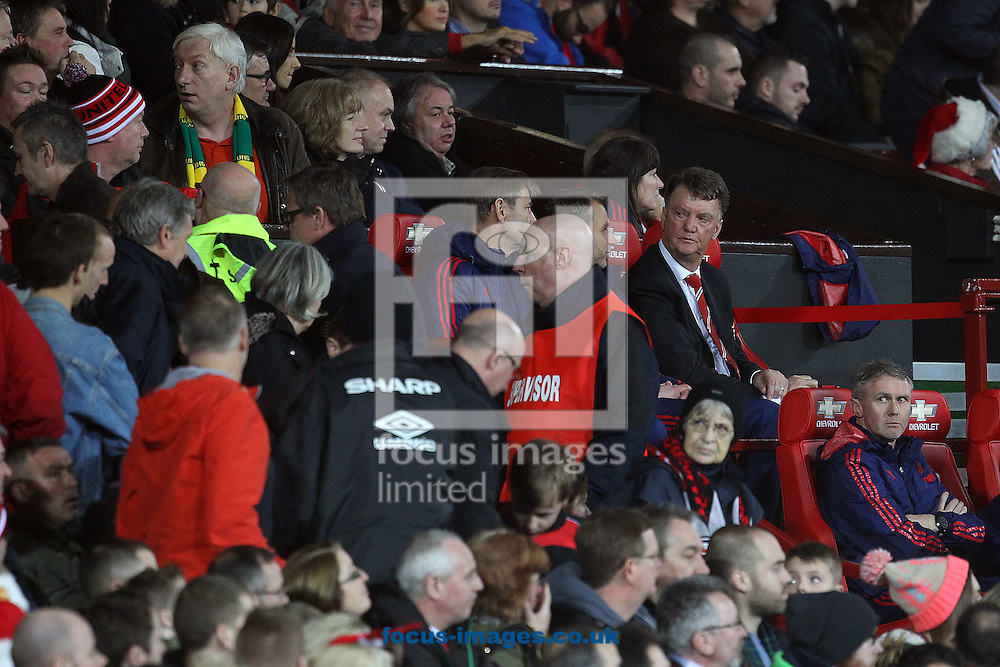 Manchester United Manager Louis van Gaal looks on as the home fans start to leave early during the Barclays Premier League match at Old Trafford, Manchester<br /> Picture by Paul Chesterton/Focus Images Ltd +44 7904 640267<br /> 19/12/2015