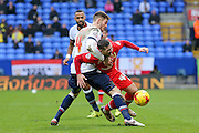 Bolton Wanderers defender Dorian Dervite  fouls MK Dons midfielder, on loan from Brighton & Hove Albion, Jake Forster-Caskey  during the Sky Bet Championship match between Bolton Wanderers and Milton Keynes Dons at the Macron Stadium, Bolton, England on 23 January 2016. Photo by Simon Davies.